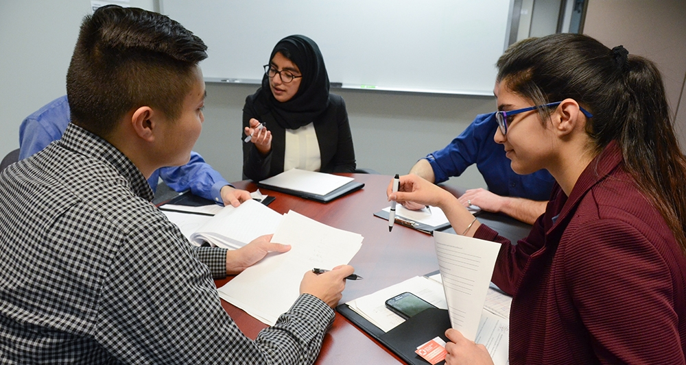 Students reviewing documents