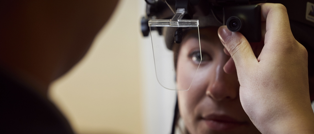 Researcher putting on eye tracking gear