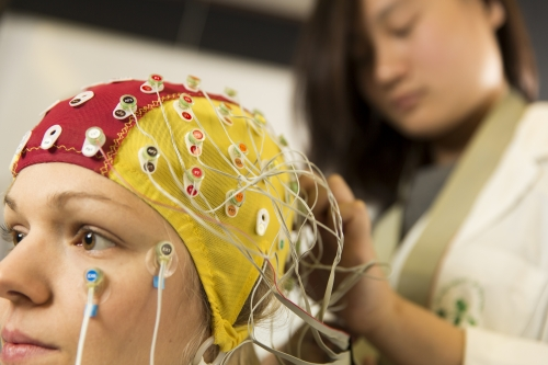 Subject fitted with a Electroencephalogram (EEG) cap to see the fine details of when brain activity occurs.