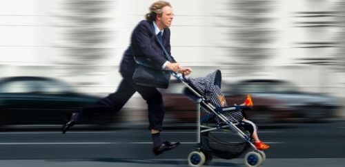 father running fast, while pushing baby buggy