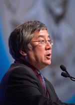 side view of Geoff Fong speaking