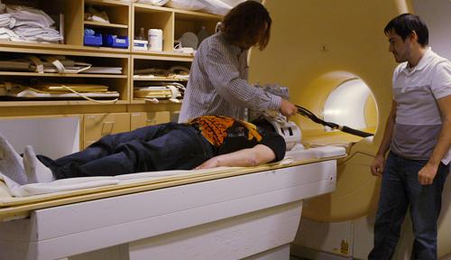 Professor James Danckert is preparing to study the brain activity