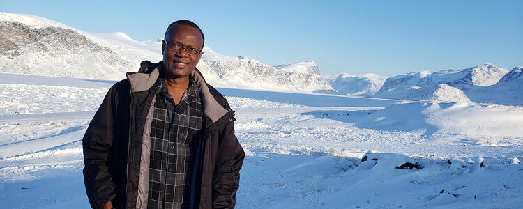 Wilfred Ntiamoah standing in arctic tundra
