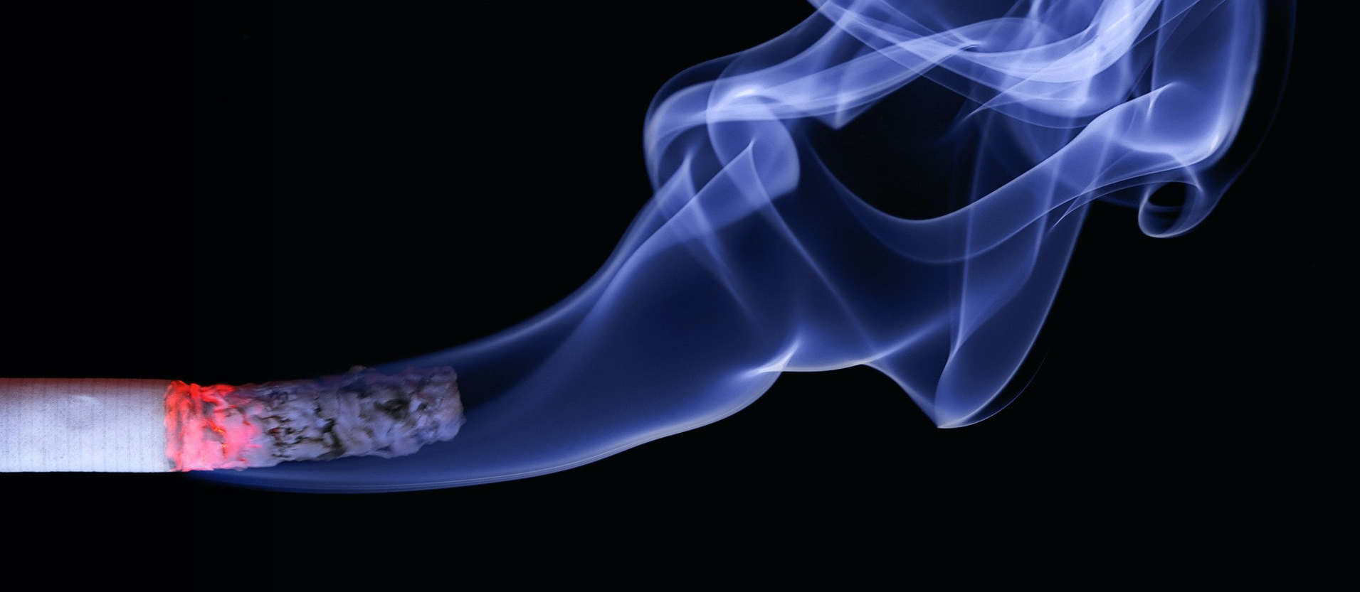 Cigarette with smoke on black background