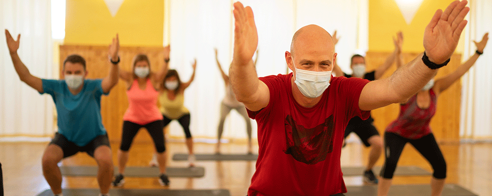 People in an exercise class with face masks on