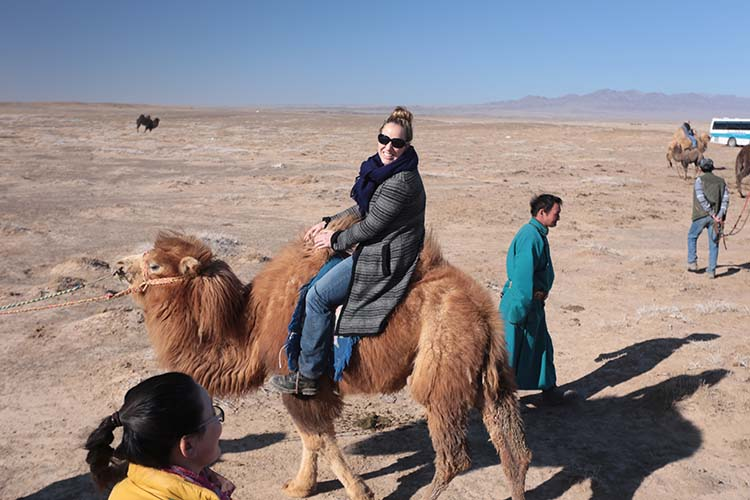 Lesley Johnson on a camel in Mongolia