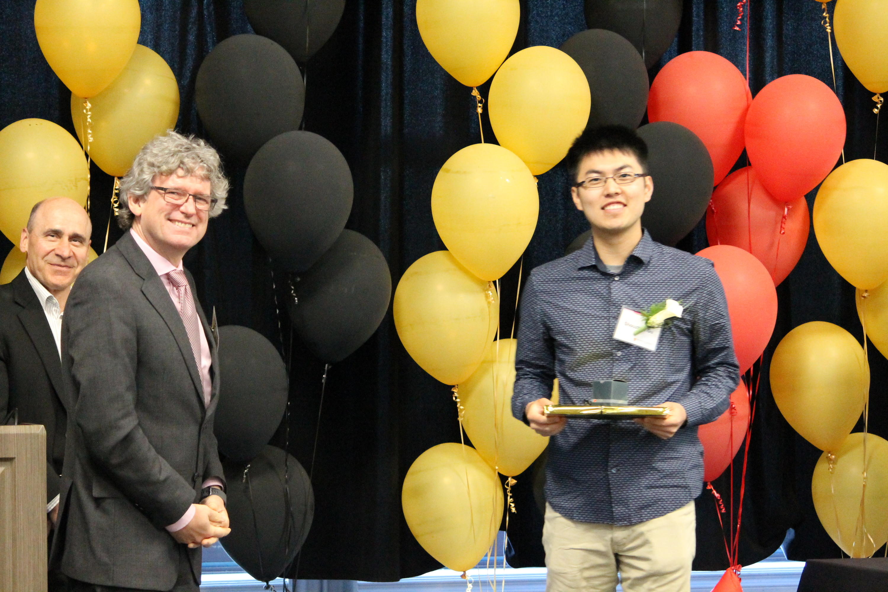 Bailey Gu is honoured by Dean Stephen Watt and Associate Dean Serge D'Alessio at the Faculty of Mathematics Convocation Dinner