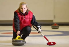 Curler releasing curling rock.