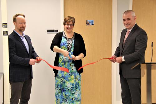 Department Chair, Dr. Troy Glover, Department Administrative Coordinator, Sandy Heise, and AHS Dean Dr. James Rush cutting the ceremonial ribbon