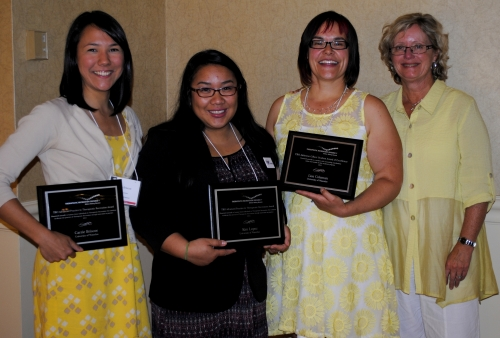 Therapeutic Recreation Ontario award winners with plaques.
