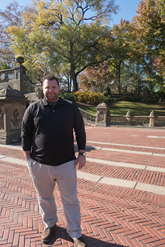 Dylan Flannery standing on brick path at Central Park, New York City