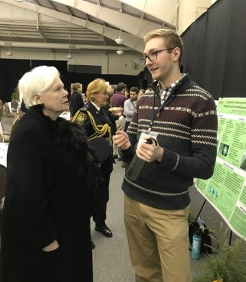 Andrew MacDonald speaking with Elizabeth Dowdeswell