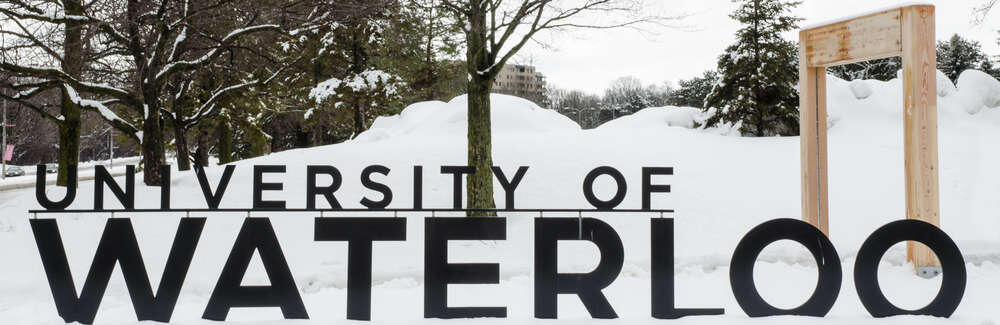 image of main entrance sign in winter