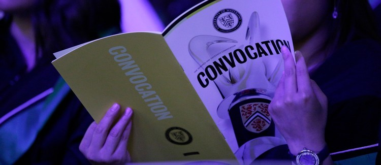 convocation booklet being viewed at a convocation ceremony