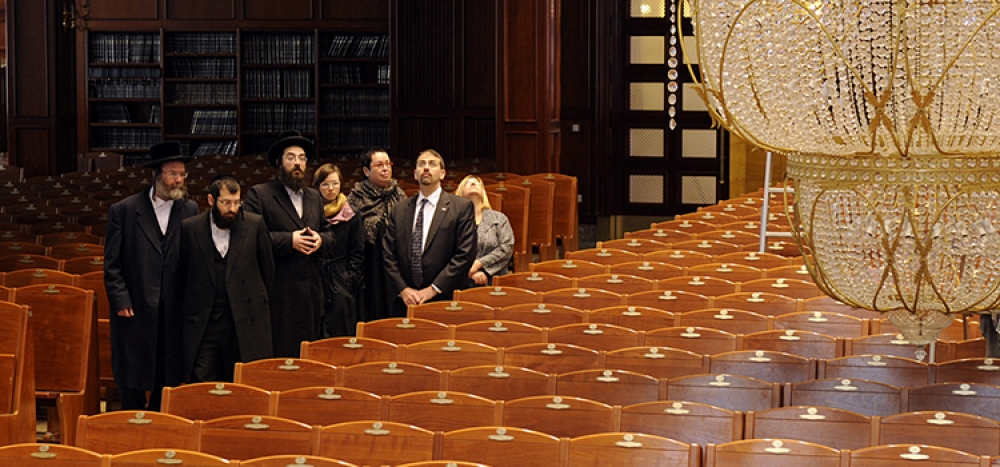 Jewish people giving tour of synagogue.