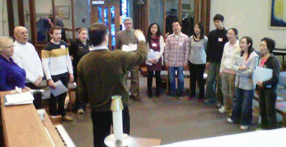 Group of workshop participants singing