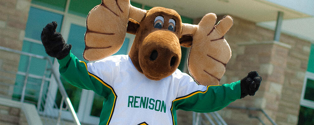 Reni the Moose with arms outstretched.