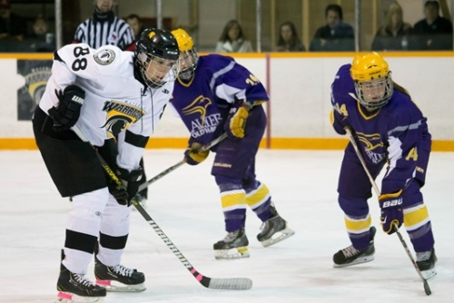 Rachel Marriott lines up for a faceoff with an opponent from WLU (ice hockey)