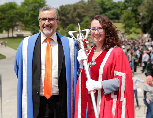 Wendy Fletcher holds the mace of the University of Waterloo, while standing next the Waterloo's president, Feridun Hamdullahpur
