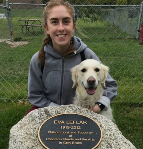 Kirsten and her dog, near the plaque with Eva Leflar's name on it.