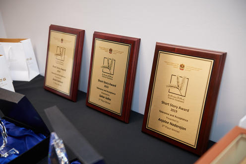 3 awards on wooden plaques.