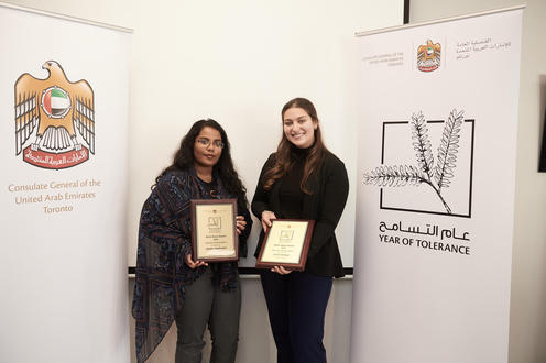 Winners Jessie Cartoon and Anjalee Nadarajan with their award plaques