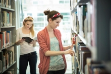 Renison students check out books in the library