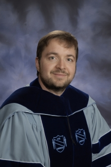 a photo of Jeff Wilson in his graduation robe
