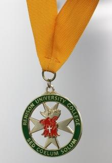 green circle with Renison badge hanging from yellow ribbon