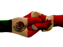 Canada and Mexico hands locked together