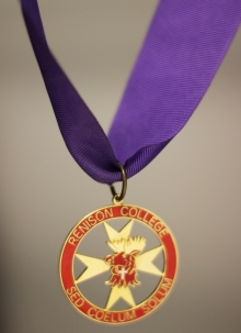 Red medal hung from a purple ribbon.