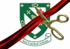 Renison's shield behind a red ribbon being cut by a gold pair of scissors.