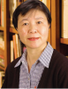 Yan Li in front of bookshelf