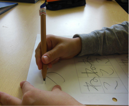 Child writing in Japanese