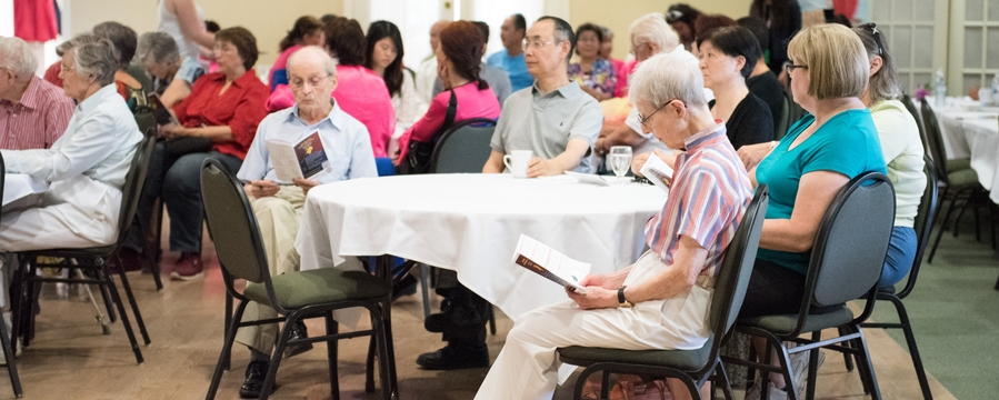 participants listen to a presentation at healthy aging practices event at Luther Village