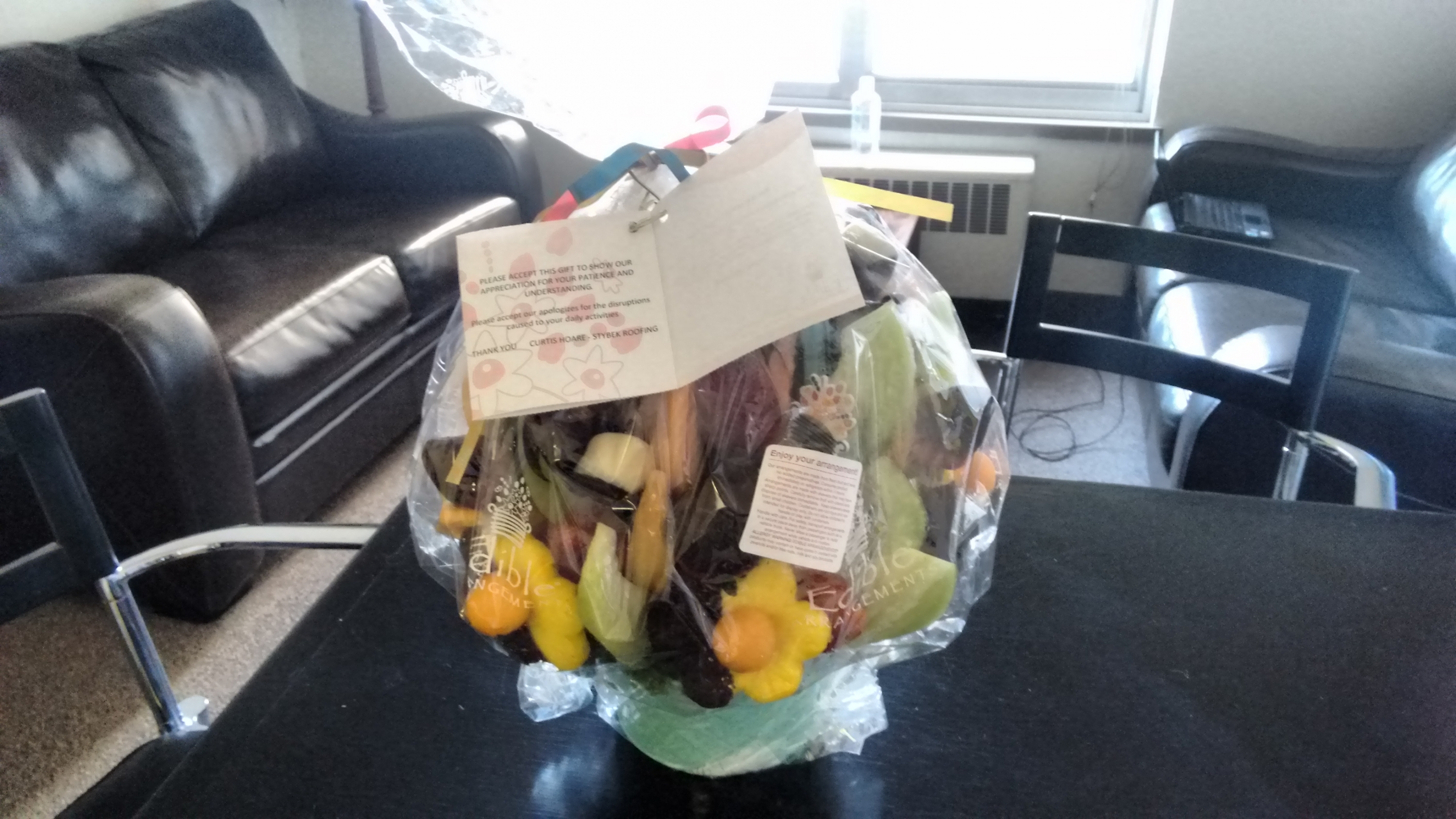 fruit basket by edible arrangements on staff room table with card