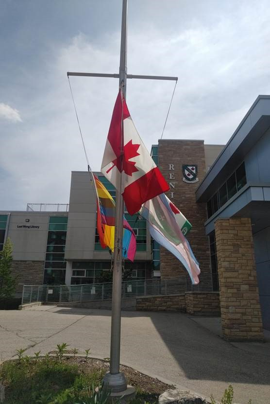 Renison flags lowered. Four flags are shown, Canadian, Renison, LGBTQ Pride, Transgender.