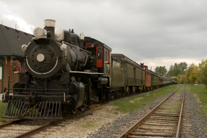 Steam train sitting at the station