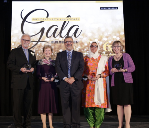 Idrisa Pandit stands along side the President of the University of Waterloo and other award winners