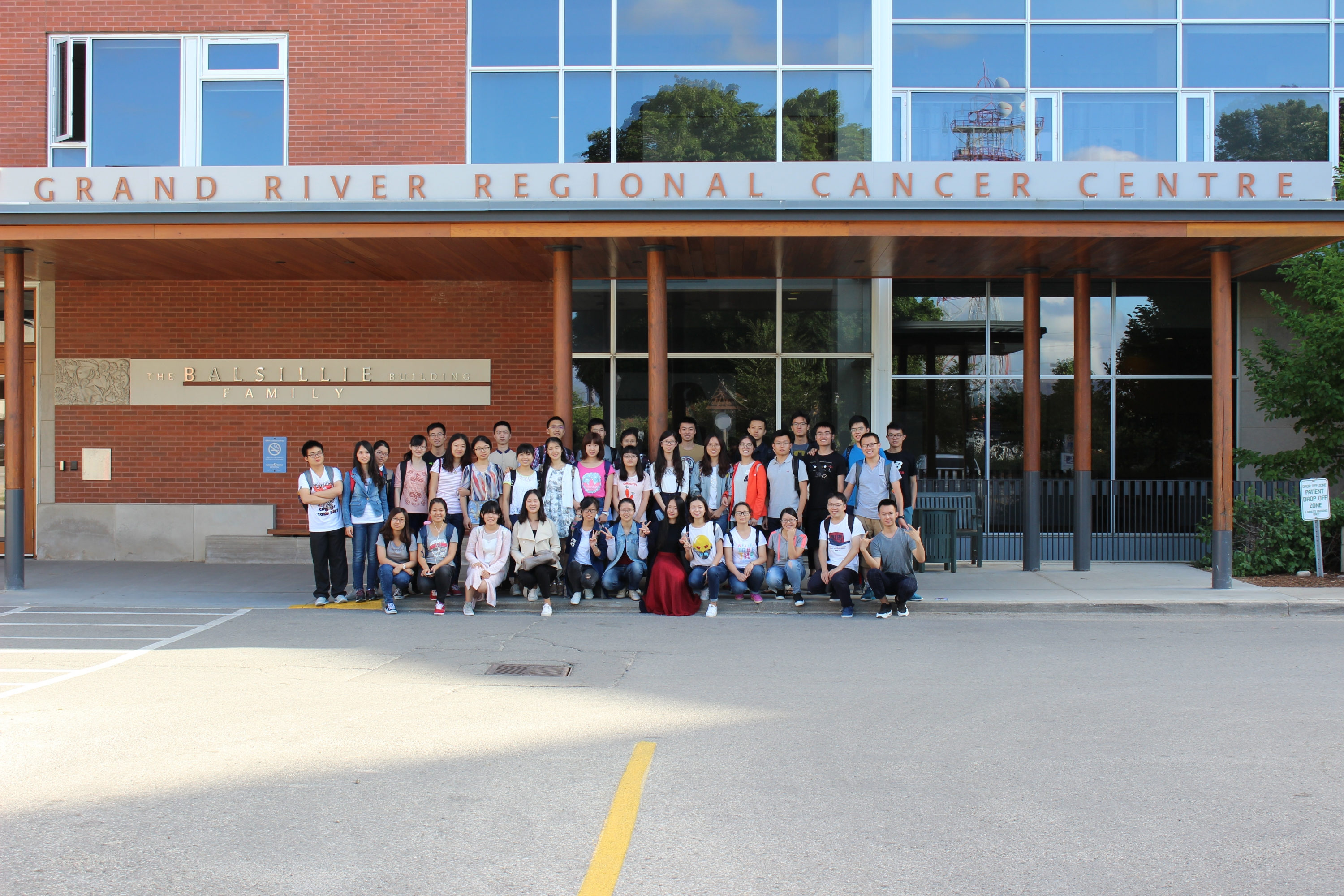 Exploring Science students pose for group photo in front of Grand River Regional Cancer Centre