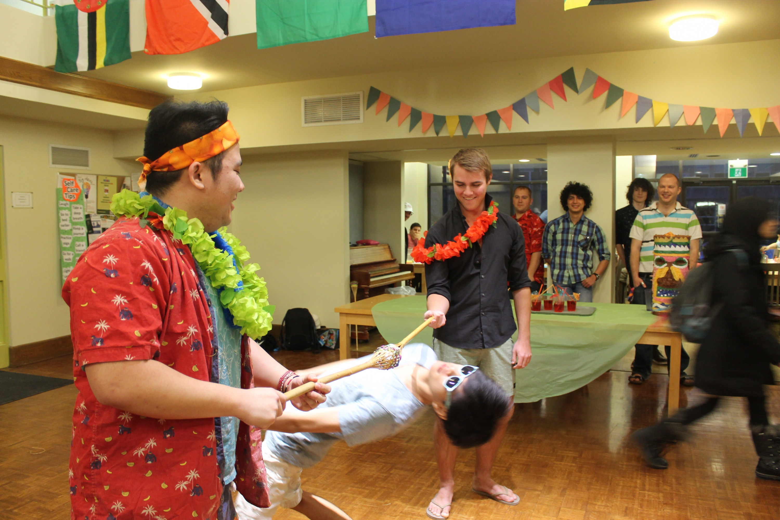 Renison residents doing limbo at Beach College Dinner