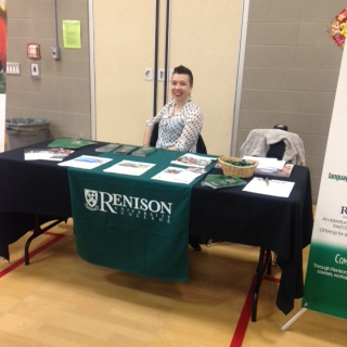 Kayla Wright sits at Renison table at COCCC Chinese New Year festival