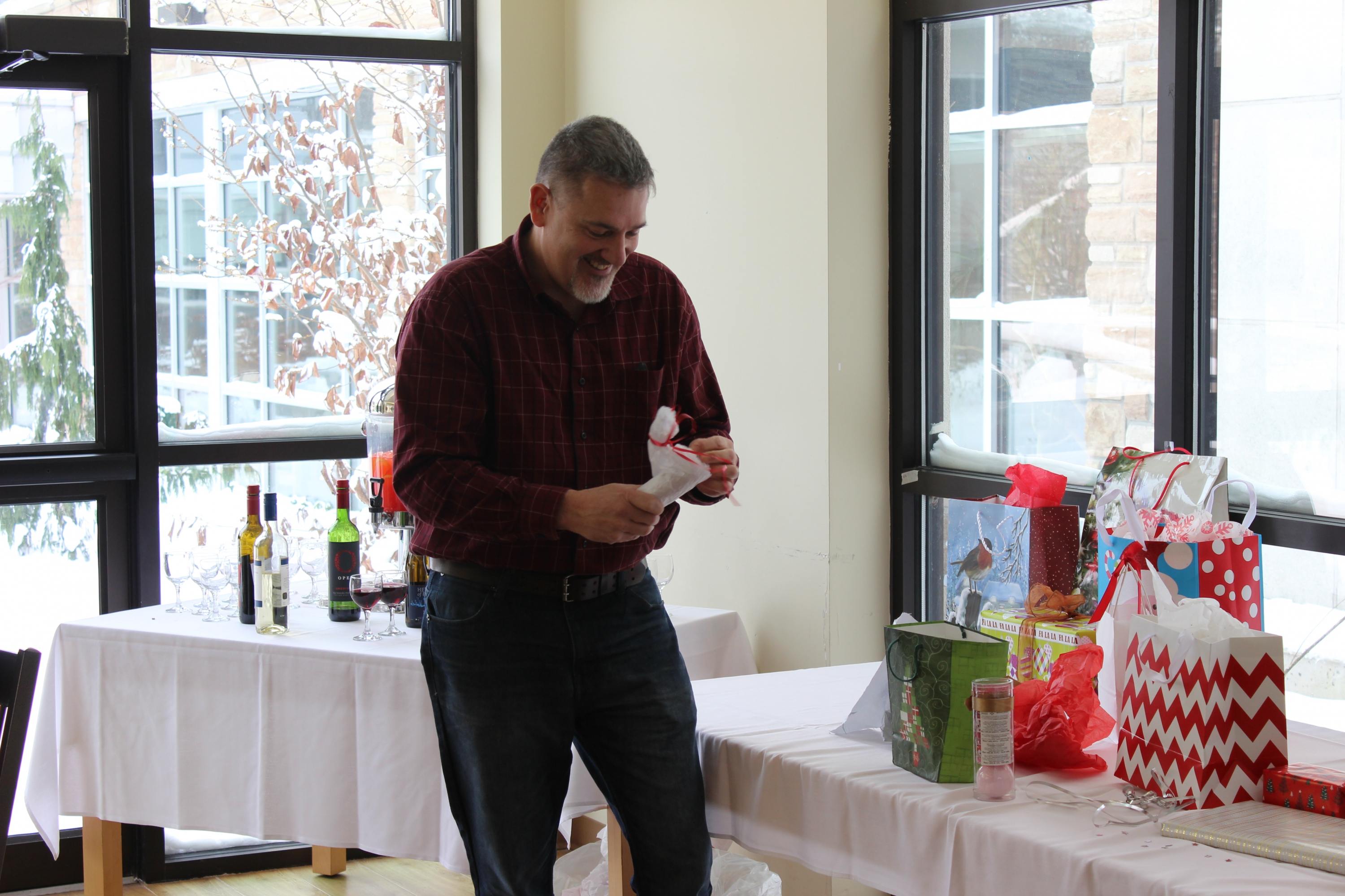 Residence Director Jeff Newell opens his white elephant gift
