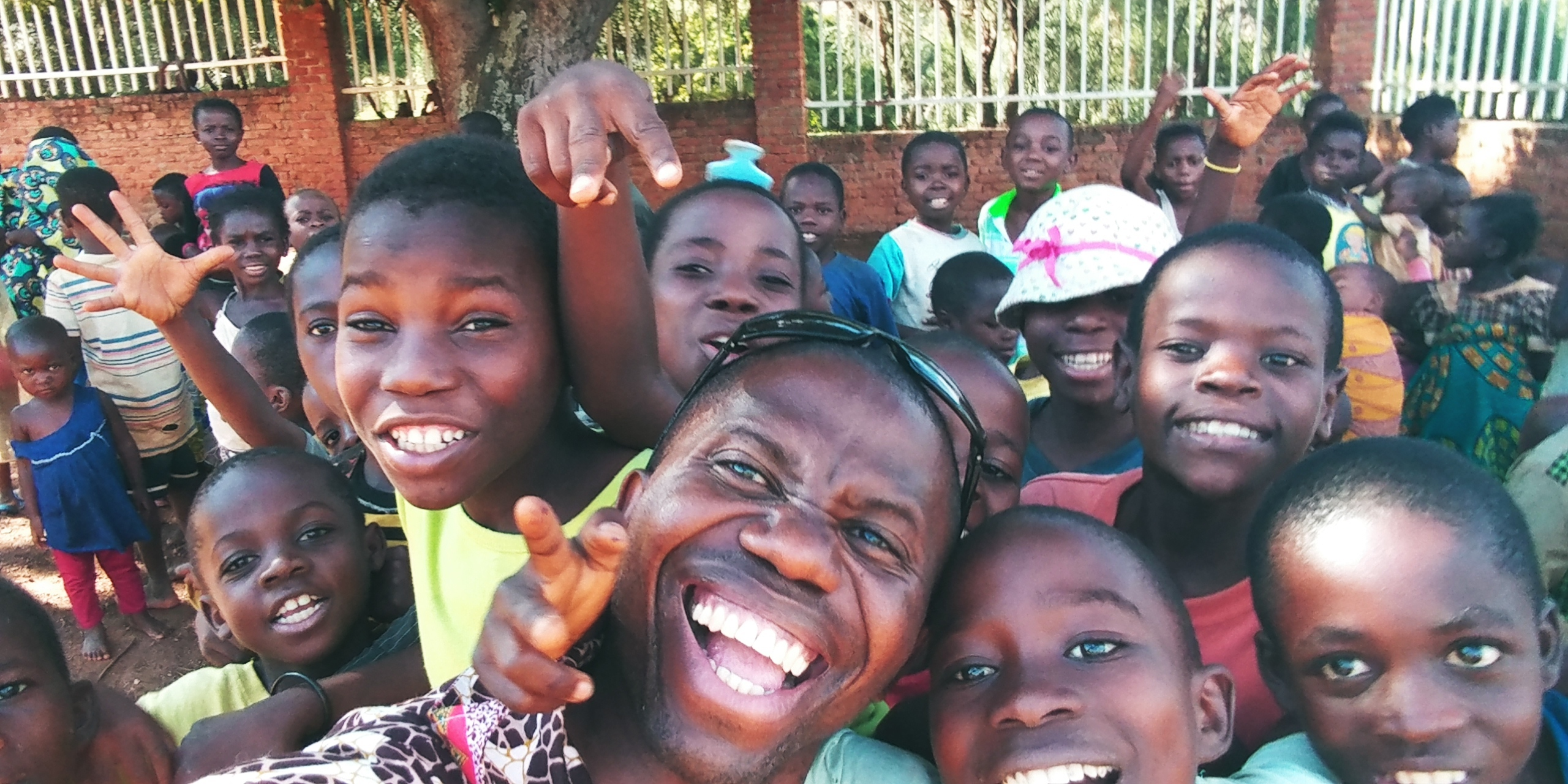 Msenwa Oliver and some of the children he works with, gathered for a selfie.