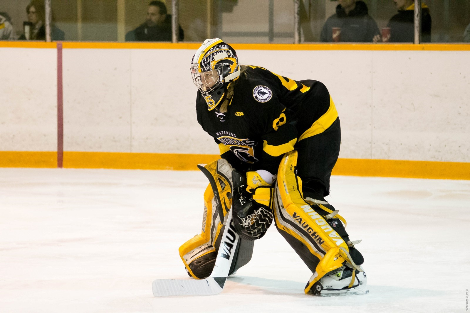 Stephanie Sluys stands at the top of her crease (ice hockey)