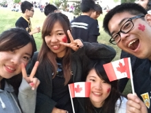 Four English for Academic Success students hold up Canada Flags at UWaterloo Canada celebration