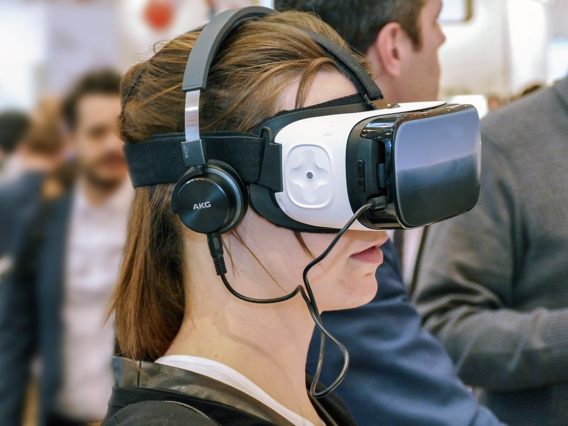 Young woman wearing a virtual reality headset and headphones.