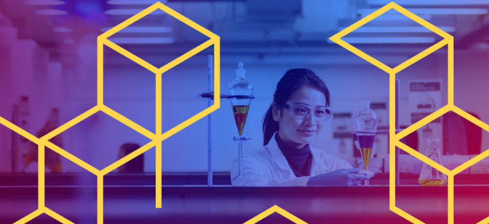 The background (it's blue, purple and pink) is a silhouette of a female Scientist holding chemicals with gold cubes on top