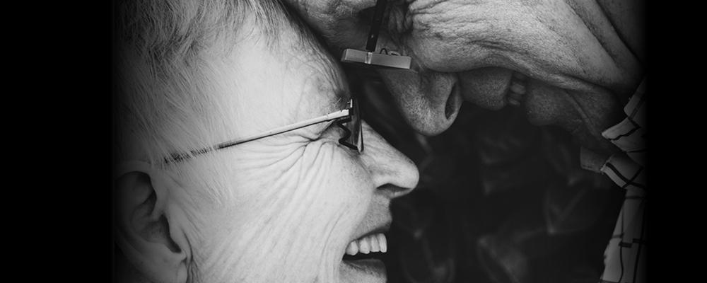Elderly couple laughing.