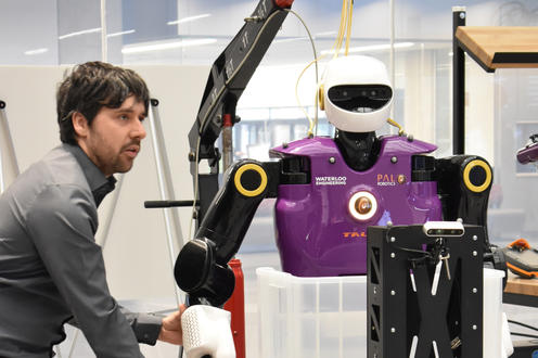 Robot with researcher